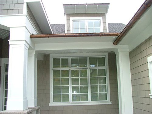 white painted house with glass windows