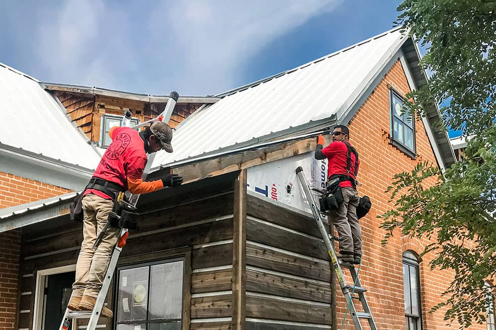 two men installing gutters